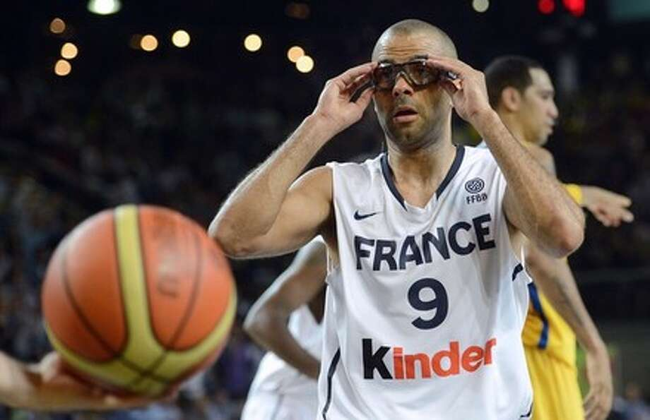 TONY PARKER, France: With his two Spurs teammates, plus NBA-ers Nicolas Batum, Ronny Turiaf and Kevin Seraphin, Parker has a good chance of leading France to the medal stand. He will play wearing goggles to protect his injured left eye. Photo: PATRICK HERTZOG, AFP/Getty Images / 2012 AFP