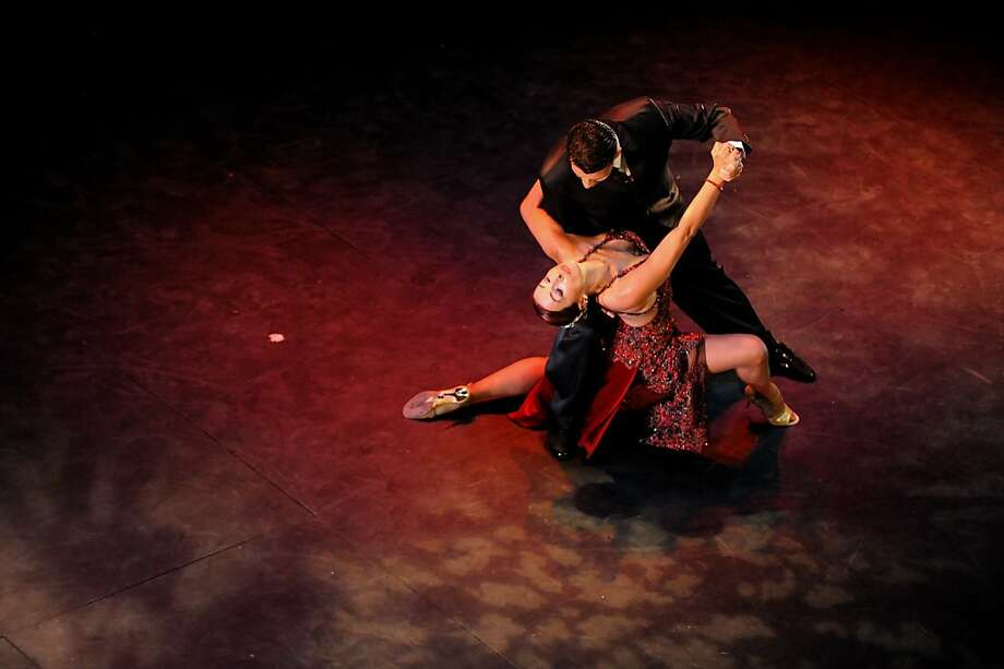 """Colombian tango dancers perform during a """"Tango Festival"""" in Cali, Colombia, on July 28, 2012. The """"Tango Festival"""" of Cali gives quotas to participate in the World Tango Championships to be held in Argentina this August. AFP PHOTO/LUIS ROBAYOLUIS ROBAYO/AFP/GettyImages Photo: Luis Robayo, AFP/Getty Images"""