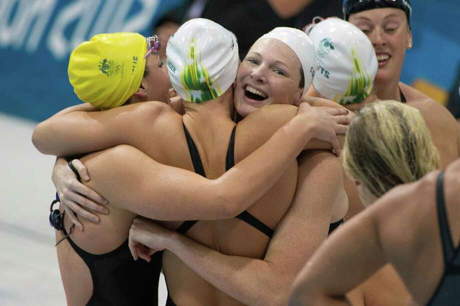 Members of Australia's 4x100-meter freestyle team celebrate after winning the gold medal at the 2012 London Olympics on Saturday, July 28, 2012. Photo: Smiley N. Pool, Houston Chronicle / © 2012  Houston Chronicle