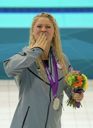 Elizabeth Beisel blows kisses to the crowd after winning the silver medal in the women's 400m IM at