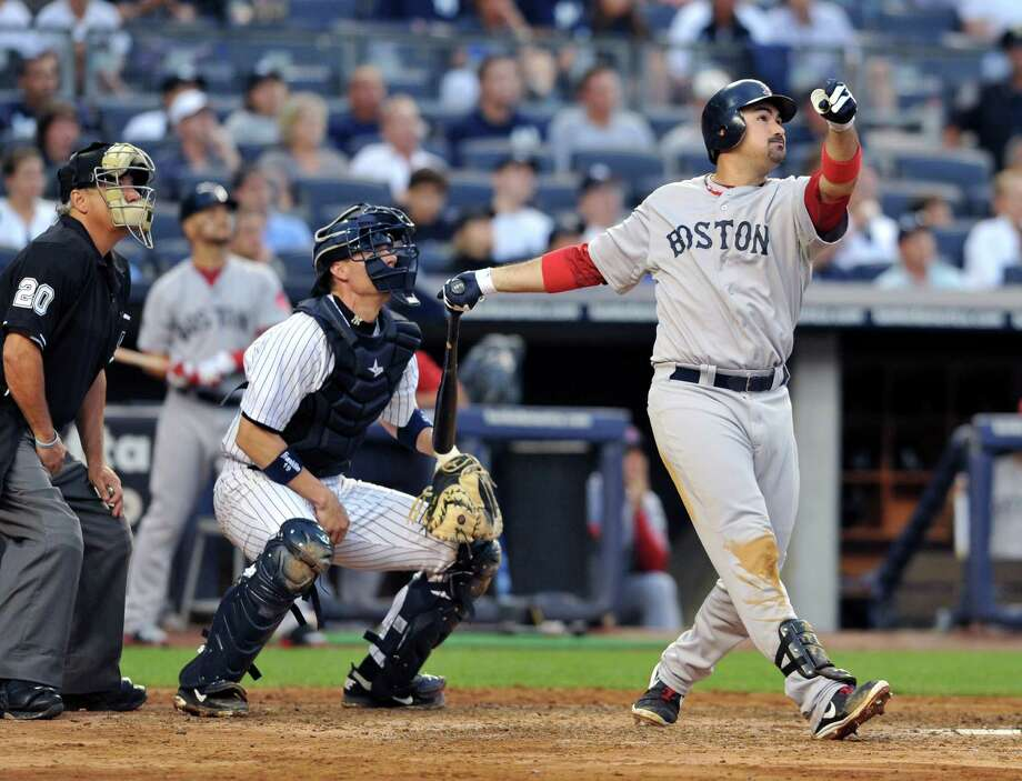 Boston Red Sox first baseman Adrian Gonzalez, right, hits a three-run home run in the fifth inning of an MLB game against the New York Yankees at the Yankee Stadium in New York, July 28, 2012. (Jason Szenes/The New York Times) Photo: JASON SZENES / NYTNS