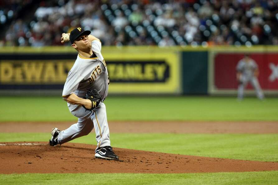 Pittsburgh's Wandy Rodriguez delivers a pitch in the first inning. (Johnny Hanson / Houston Chronicl