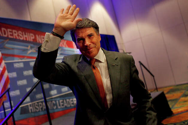 Governor Rick Perry waves to the audience after speaking at the Hispanic Leadership Network's Small Business Invitational at the Marriott Rivercenter Hotel in San Antonio on Saturday, July 28, 2012. Photo: Lisa Krantz, San Antonio Express-News / San Antonio Express-News