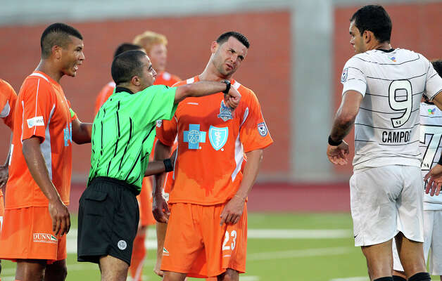Carolina's Nick Zimmerman loses his appeal to the ref after the Scorpions' Pablo Campos was fouled near the goal as San Antonio plays the Railhawks at Heroes Stadium on Saturday, July 28, 2012. Photo: Tom Reel, San Antonio Express-News / ©2012 San Antono Express-News