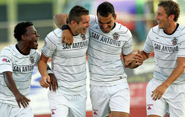 Scorpions teammates congratulate Greg Janicki (left center) after he scored the first goal as San Antonio plays the Carolina Railhawks at Heroes Stadium on Saturday, July 28, 2012. Photo: Tom Reel, San Antonio Express-News / ©2012 San Antono Express-News