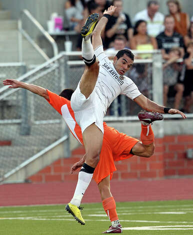 The Scorpions' Pablo Campos is upended as San Antonio plays the Carolina Railhawks at Heroes Stadium on Saturday, July 28, 2012. Photo: Tom Reel, San Antonio Express-News / ©2012 San Antono Express-News