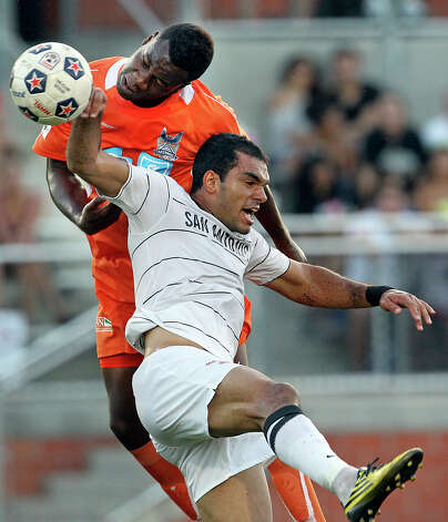 The Scorpions' Pablo Campos is fouled over the back on a header try by Carolina's Gale Aqbossoumonde as San Antonio plays the Railhawks at Heroes Stadium on Saturday, July 28, 2012. Photo: Tom Reel, San Antonio Express-News / ©2012 San Antono Express-News