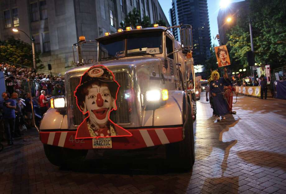 The Seafair Clowns honor J.P. Patches during the Seafair Torchlight Parade on Saturday, July 28, 2012. Actor Chris Wedes, who played the character, died recently. Photo: JOSHUA TRUJILLO / SEATTLEPI.COM