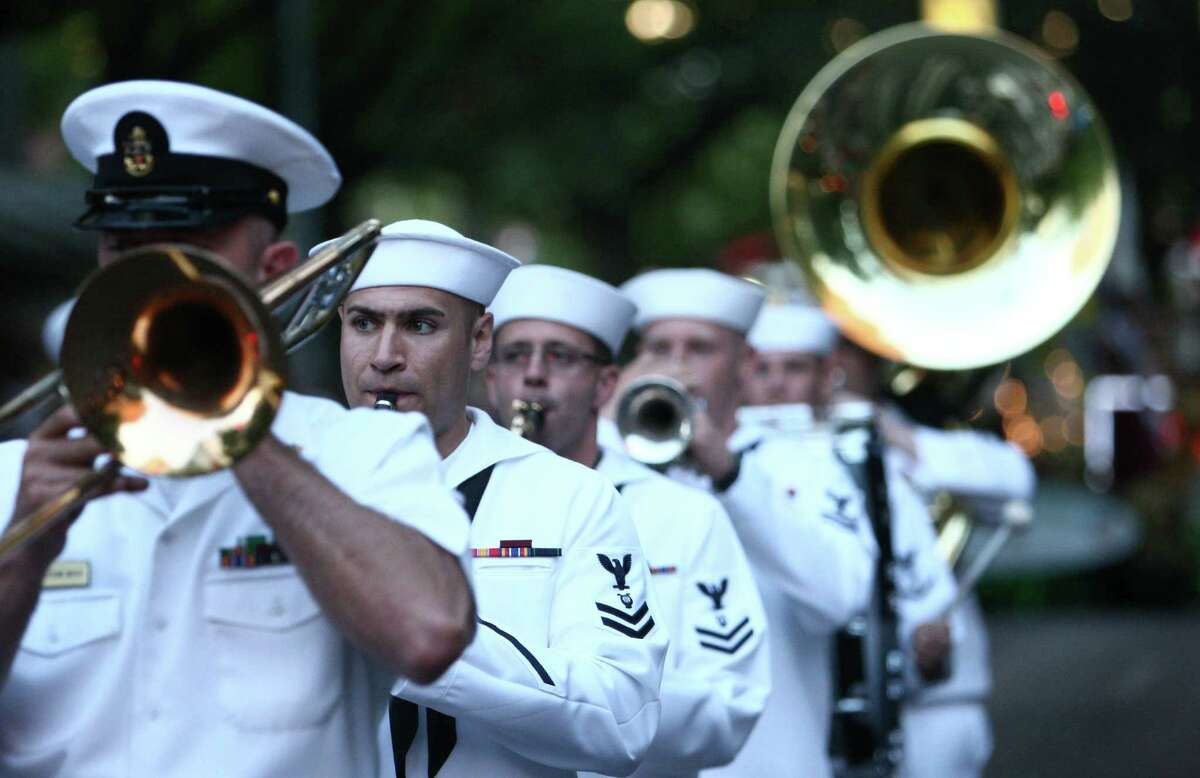 U.S. Navy band members march during the Seafair Torchlight Parade on Saturday, July 28, 2012.