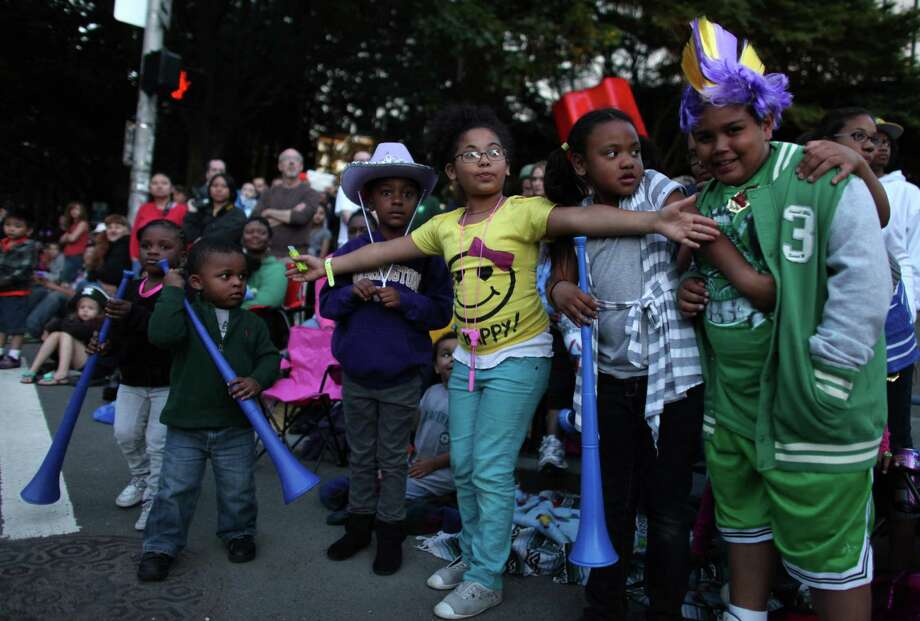 Young spectators are held back as dragon dancers approach during the Seafair Torchlight Parade on Saturday, July 28, 2012. Photo: JOSHUA TRUJILLO / SEATTLEPI.COM