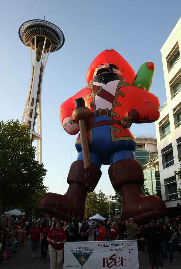 The Seafair inflatable pirate begins its trek along the route during the Seafair Torchlight Parade on Saturday, July 28, 2012. Photo: JOSHUA TRUJILLO / SEATTLEPI.COM