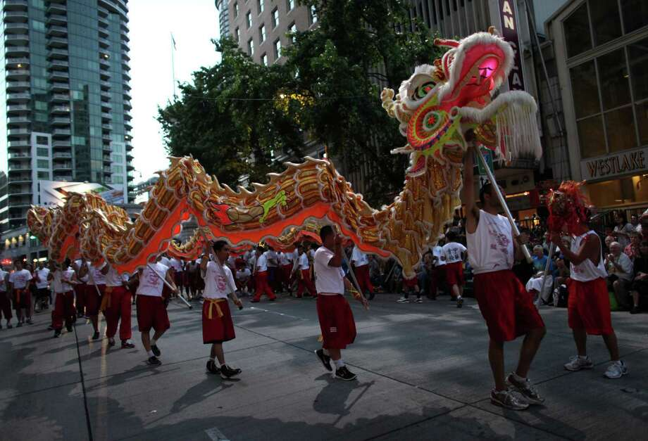 Members of the Seattle Chinatown Dragon Team perform during the Seafair Torchlight Parade on Saturday, July 28, 2012. Photo: JOSHUA TRUJILLO / SEATTLEPI.COM