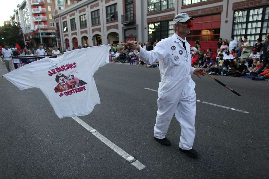 Kevin Roundtree honors JP Patches as he marches along the route during the Seafair Torchlight Parade on Saturday, July 28, 2012. Photo: JOSHUA TRUJILLO / SEATTLEPI.COM