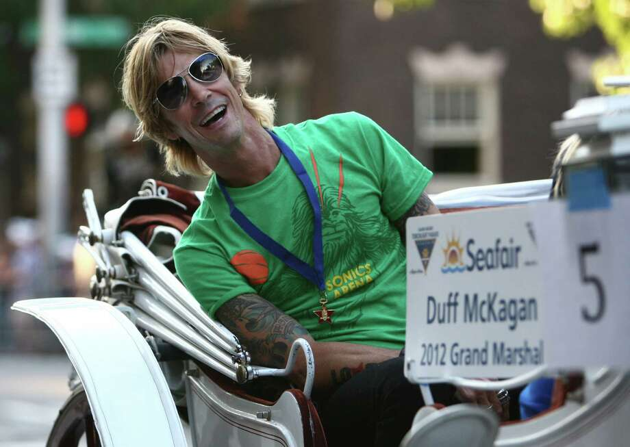 Seafair Torchlight Parade Grand Marshall Duff McKagan rides in a carriage during the parade on Saturday, July 28, 2012. Photo: JOSHUA TRUJILLO / SEATTLEPI.COM