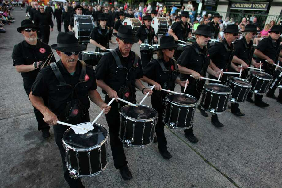 Drummers march along the route during the Seafair Torchlight Parade on Saturday, July 28, 2012. Photo: JOSHUA TRUJILLO / SEATTLEPI.COM
