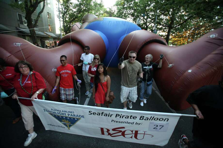 An inflatable pirate is maneuvered along the route during the Seafair Torchlight Parade on Saturday, July 28, 2012. Photo: JOSHUA TRUJILLO / SEATTLEPI.COM