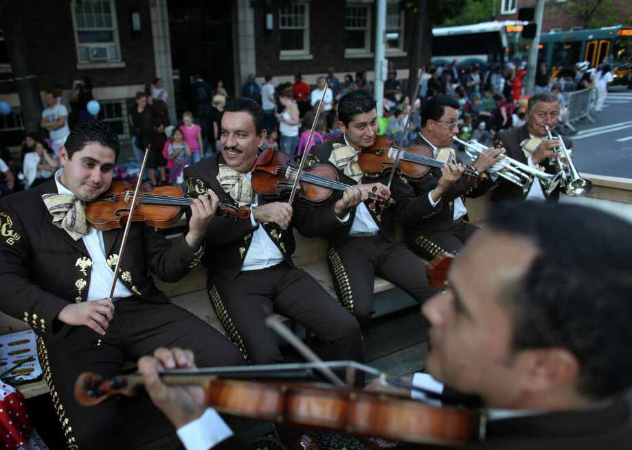 Mariachis perform on the Ixtapa Restaurant float during the Seafair Torchlight Parade on Saturday, July 28, 2012. Photo: JOSHUA TRUJILLO / SEATTLEPI.COM