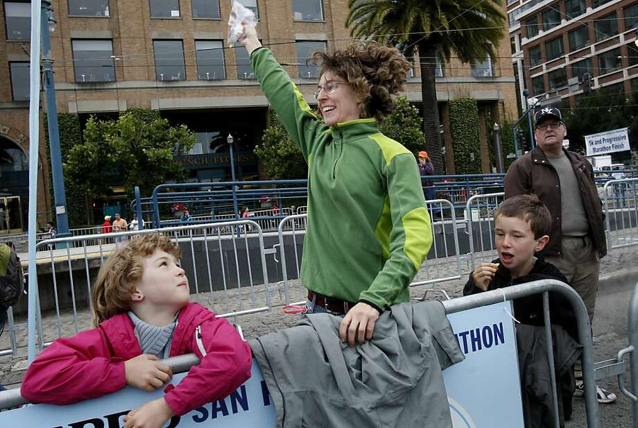 Lucia DeStefano waved as her husband finished his marathon. The annual San Francisco Marathon starts and ends on the Embarcadero.  Marathon runners also ran across a foggy Golden Gate Bridge Sunday July 29, 2012. Photo: Brant Ward, The Chronicle