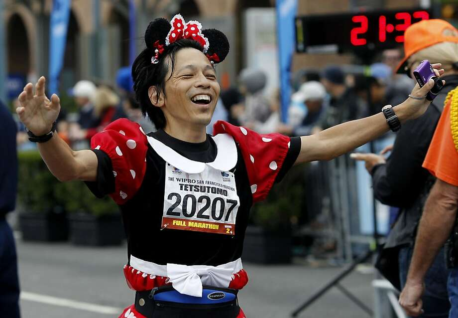 Tetsutomo Iizuka, from Japan, showed his love for Disney movies in the running outfit. The annual San Francisco Marathon starts and ends on the Embarcadero.  Marathon runners also ran across a foggy Golden Gate Bridge Sunday July 29, 2012. Photo: Brant Ward, The Chronicle