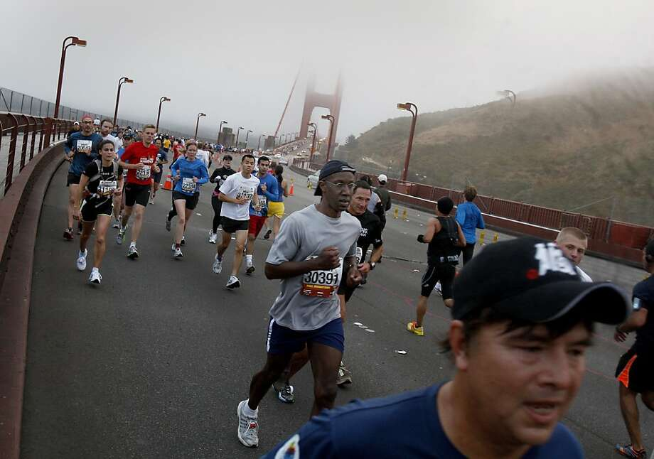 Marathon runners neared the turn around at Vista Point. The annual San Francisco Marathon starts and ends on the Embarcadero.  Marathon runners also ran across a foggy Golden Gate Bridge Sunday July 29, 2012. Photo: Brant Ward, The Chronicle