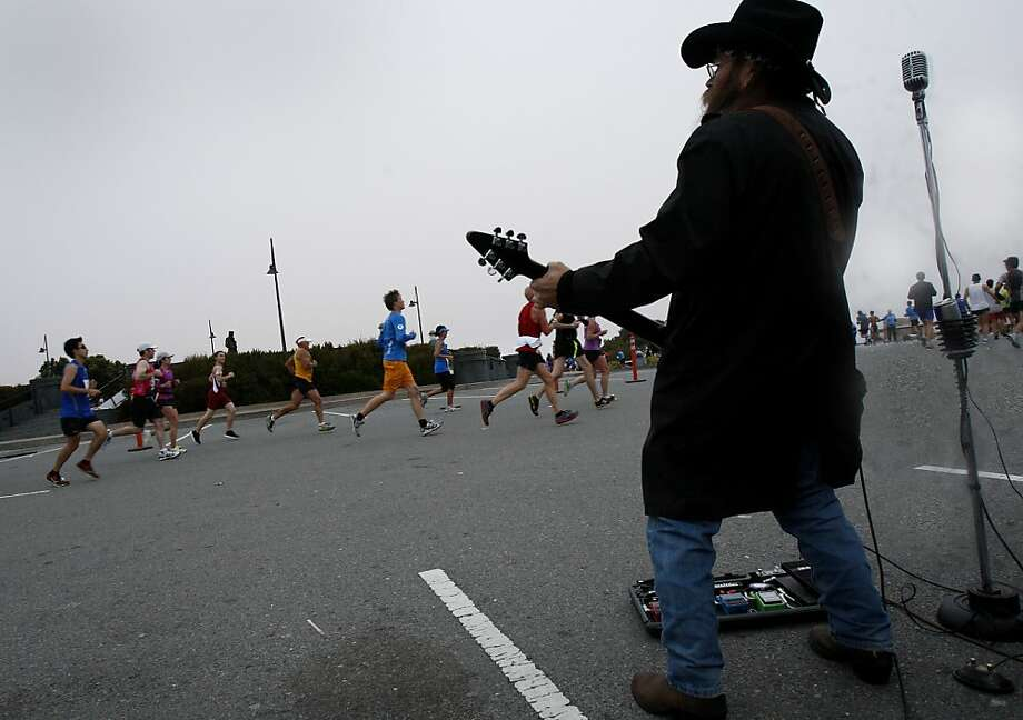 The Gillbillies entertained the runners at Vista Point on the Golden Gate Bridge. The annual San Francisco Marathon starts and ends on the Embarcadero.  Marathon runners also ran across a foggy Golden Gate Bridge Sunday July 29, 2012. Photo: Brant Ward, The Chronicle