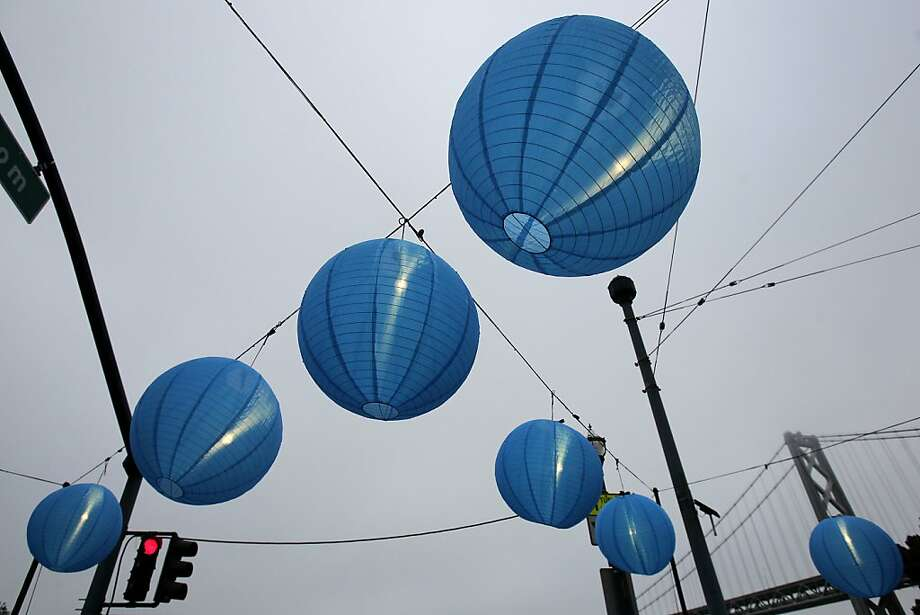 A group of large blue lanterns greeted runners at the finish line. The annual San Francisco Marathon starts and ends on the Embarcadero.  Marathon runners also ran across a foggy Golden Gate Bridge Sunday July 29, 2012. Photo: Brant Ward, The Chronicle