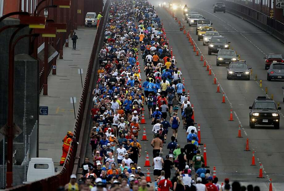 A view from Vista Point as runners made their way across the Golden Gate Bridge. The annual San Francisco Marathon starts and ends on the Embarcadero.  Marathon runners also ran across a foggy Golden Gate Bridge Sunday July 29, 2012. Photo: Brant Ward, The Chronicle