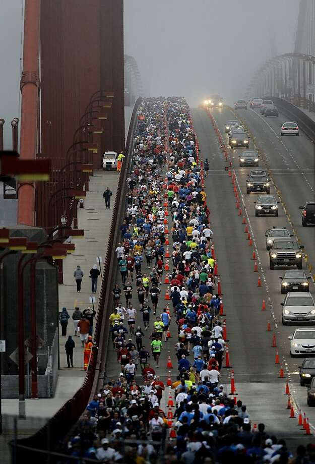 The Golden Gate Bridge was mostly in fog when the runners crossed. The annual San Francisco Marathon starts and ends on the Embarcadero.  Marathon runners also ran across a foggy Golden Gate Bridge Sunday July 29, 2012. Photo: Brant Ward, The Chronicle
