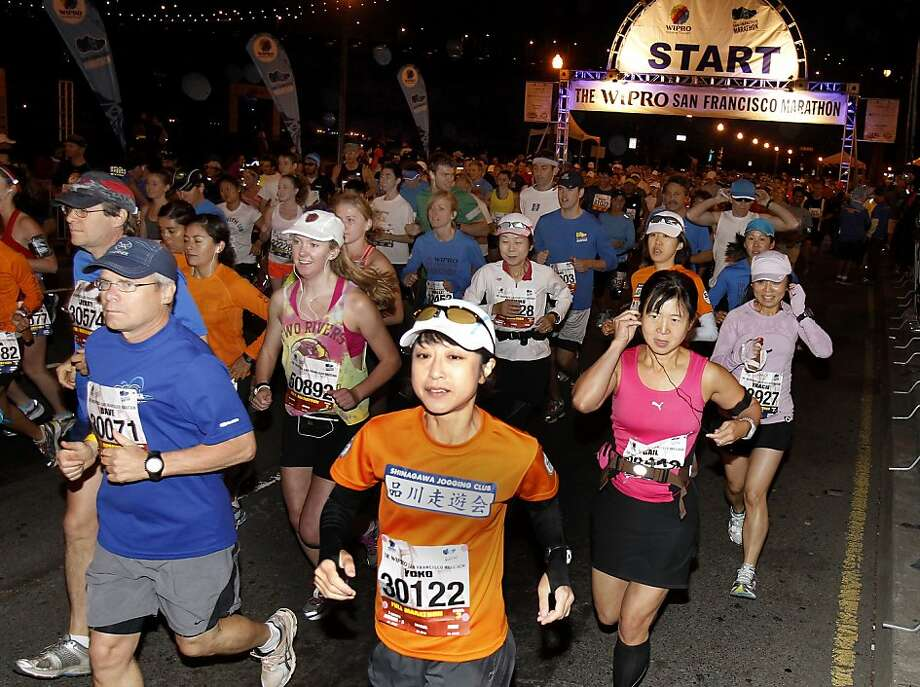 Marathon runners begin their run just before 6 am. The annual San Francisco Marathon starts and ends on the Embarcadero.  Marathon runners also ran across a foggy Golden Gate Bridge Sunday July 29, 2012. Photo: Brant Ward, The Chronicle