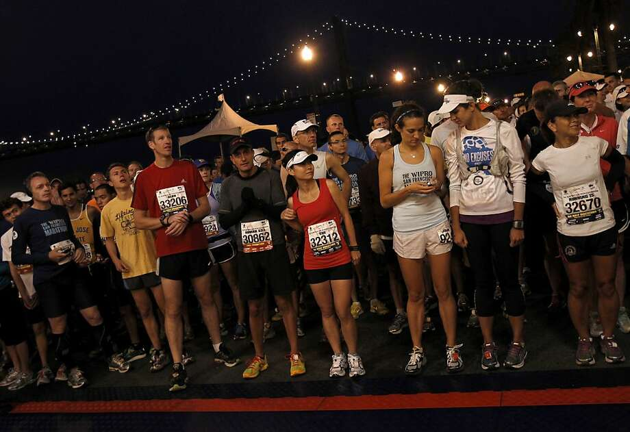 Marathon runners in the third wave got ready to start the race. The annual San Francisco Marathon starts and ends on the Embarcadero.  Marathon runners also ran across a foggy Golden Gate Bridge Sunday July 29, 2012. Photo: Brant Ward, The Chronicle