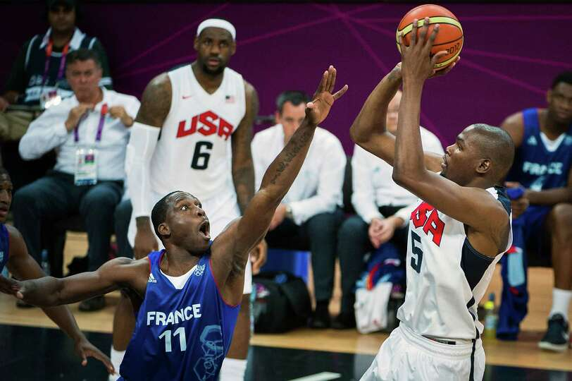 USA's Kevin Durant shoots over France's Florent Pietrus during men's preliminary round basketball at