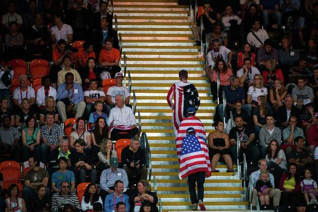 USA fans head to their seats as their team faces France during men's preliminary round basketball at the 2012 London Olympics on Sunday, July 29, 2012. Photo: Smiley N. Pool, Houston Chronicle / © 2012  Houston Chronicle