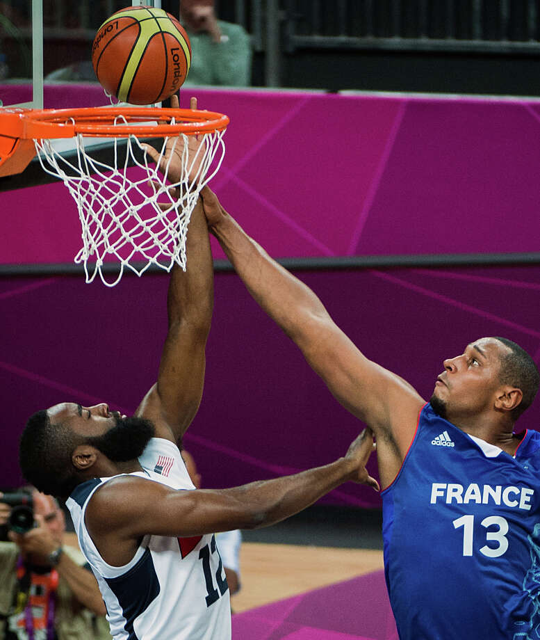 France's Boris Diaw fights for a rebound against USA's James Harden during men's preliminary round basketball at the 2012 London Olympics on Sunday, July 29, 2012. Photo: Smiley N. Pool, Houston Chronicle / © 2012  Houston Chronicle
