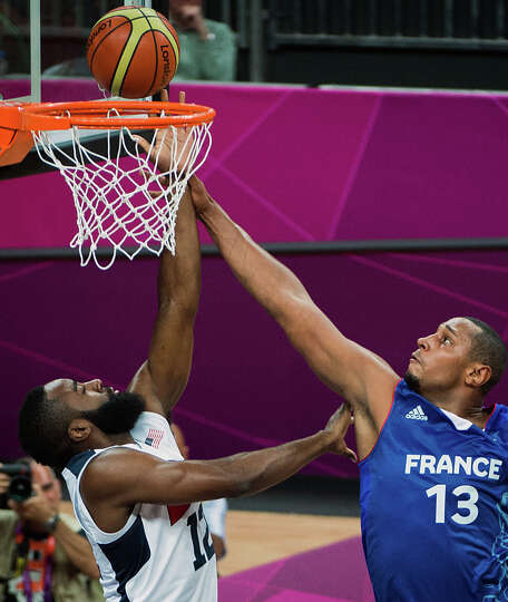 France's Boris Diaw fights for a rebound against USA's James Harden during men's preliminary round b