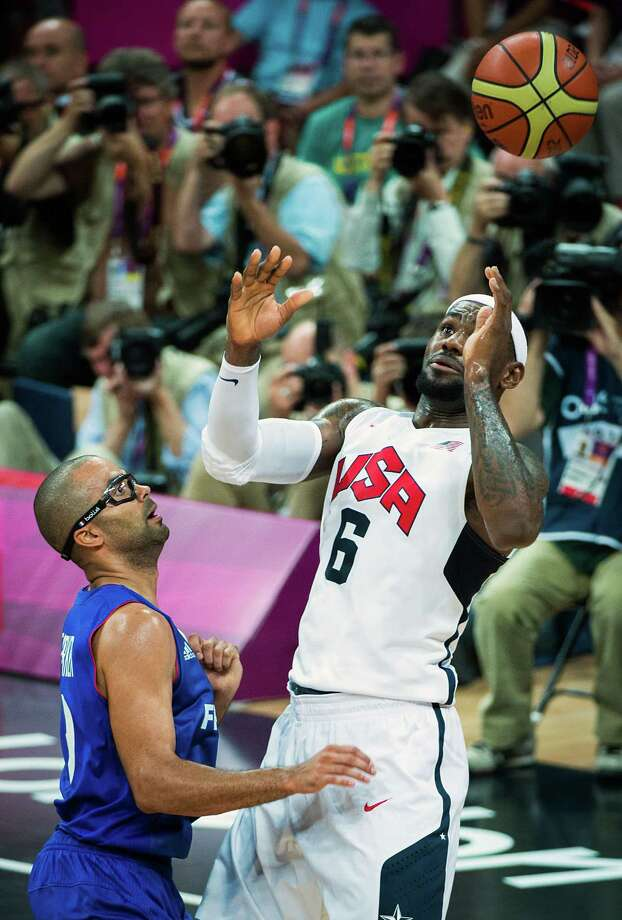 USA's Lebron James loses the ball as France's Tony Parker defends during men's preliminary round basketball at the 2012 London Olympics on Sunday, July 29, 2012. Photo: Smiley N. Pool, Houston Chronicle / © 2012  Houston Chronicle