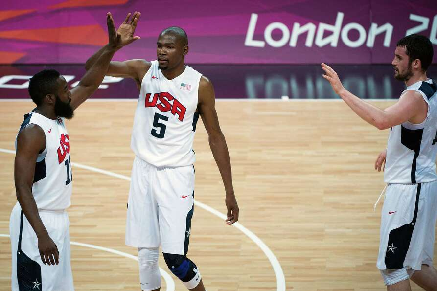 USA's Kevin Durant (5) celebrates with James Harden after making a basket during men's preliminary r