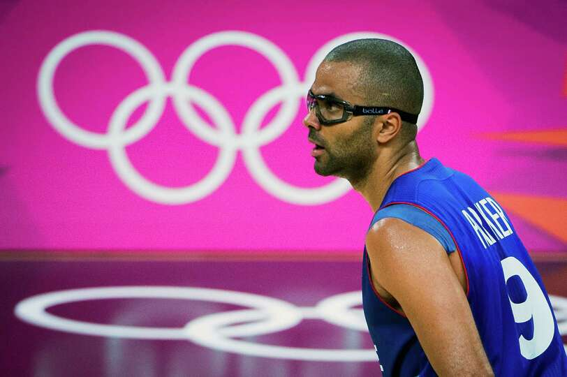 France's Tony Parker brings the ball up the court during men's preliminary round basketball against