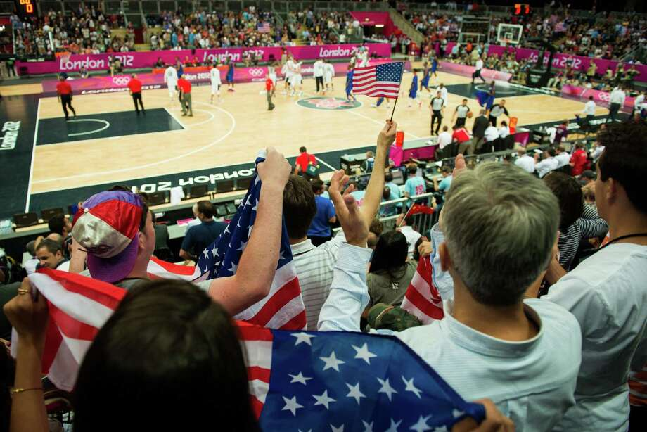 USA fans cheer their team as they leave the field for halftime against France during men's preliminary round basketball at the 2012 London Olympics on Sunday, July 29, 2012. Photo: Smiley N. Pool, Houston Chronicle / © 2012  Houston Chronicle