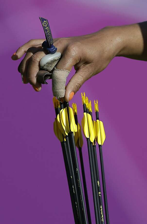 India's Bombayla Devi Laishram grabs an arrow from her quiver during the women's archery team competition at the 2012 Summer Olympics, Sunday, July 29, 2012, in London. (AP Photo/Marcio Jose Sanchez) Photo: Marcio Jose Sanchez, Associated Press
