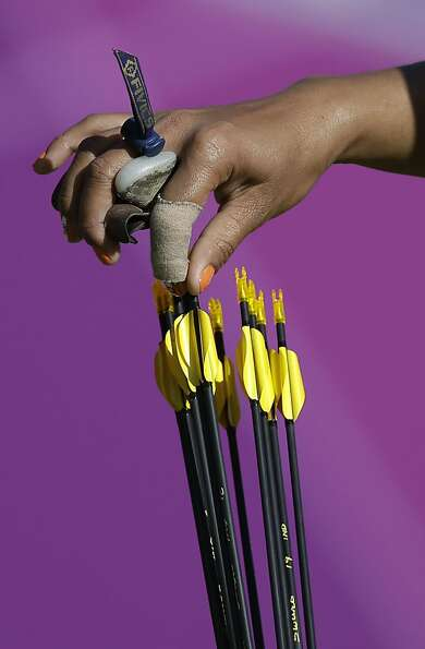 India's Bombayla Devi Laishram grabs an arrow from her quiver during the women's archery team compet