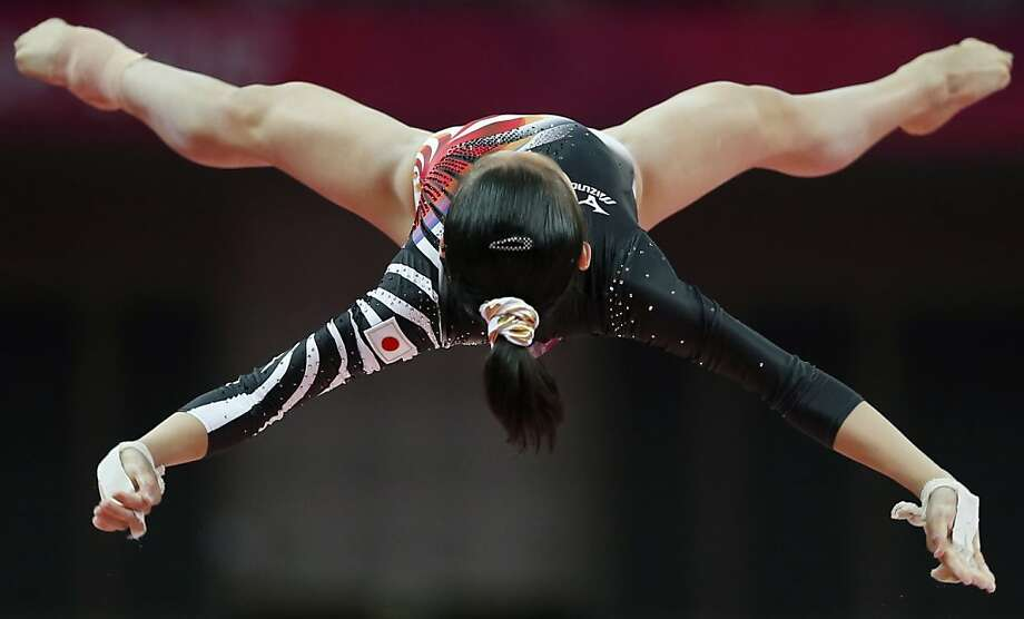 Japanese gymnast Yu Minobe performs on the uneven bars during the artistic gymnastics women's qualifications at the 2012 Summer Olympics, Sunday, July 29, 2012, in London. (AP Photo/Matt Dunham) Photo: Matt Dunham, Associated Press