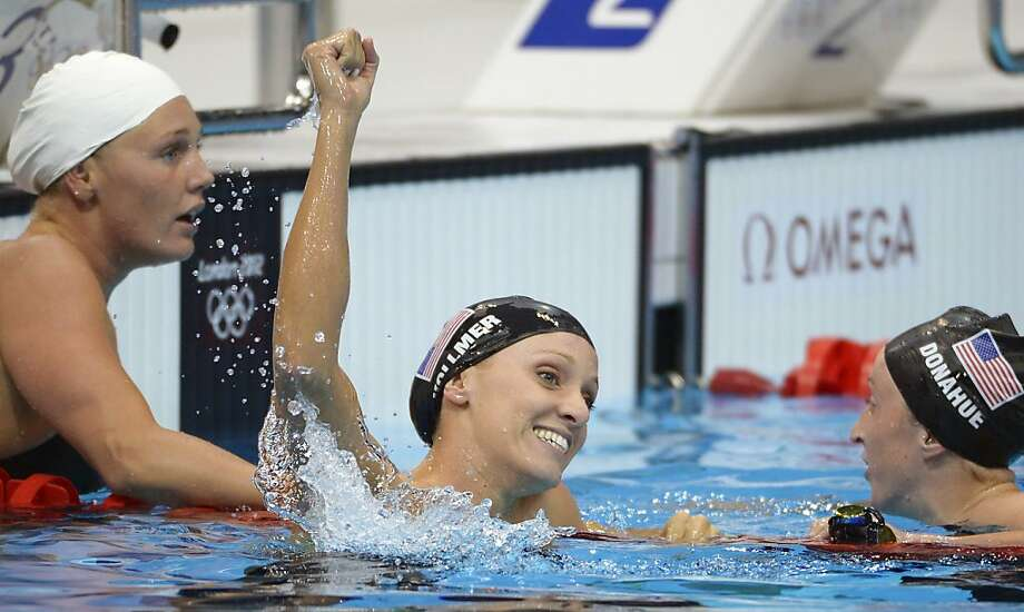 United States' Dana Vollmer, center, reacts after winning gold and setting a world record in the women's 100-meter butterfly swimming final at the Aquatics Centre in the Olympic Park during the 2012 Summer Olympics in London, Sunday, July 29, 2012. Vollmer set a new world record with a time of 55.98. (AP Photo/Mark J. Terrill) Photo: Mark J. Terrill, Associated Press