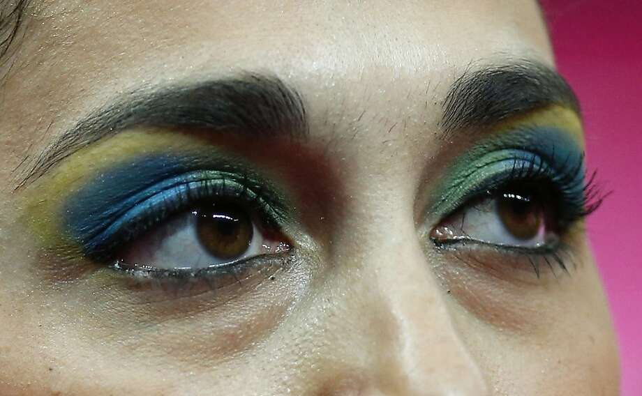 Brazilian gymnast Daniele Matias Hypolito, wearing eye makeup in the colors of the national flag, waits to perform during the artistic gymnastics women's qualifications at the 2012 Summer Olympics, Sunday, July 29, 2012, in London. (AP Photo/Matt Dunham) Photo: Matt Dunham, Associated Press
