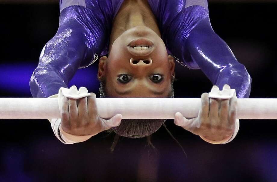U.S. gymnast Gabrielle Douglas performs on the uneven bars during the Artistic Gymnastics women's qualification at the 2012 Summer Olympics, Sunday, July 29, 2012, in London. (AP Photo/Gregory Bull) Photo: Gregory Bull, Associated Press