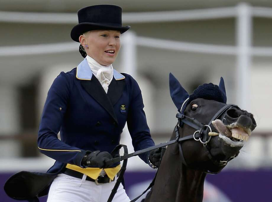 Malin Petersen, of Sweden, and her horse Sofarsogood, exit the ring after competing in the equestrian eventing dressage phase at the 2012 Summer Olympics, Sunday, July 29, 2012, in London. (AP Photo/David Goldman) Photo: David Goldman, Associated Press