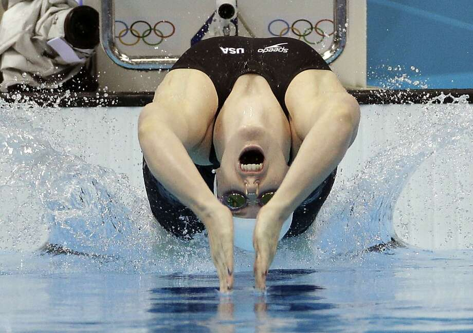United States' Missy Franklin starts in a women's 100-meter backstroke swimming heat at the Aquatics Centre in the Olympic Park during the 2012 Summer Olympics in London, Sunday, July 29, 2012. (AP Photo/Michael Sohn) Photo: Michael Sohn, Associated Press