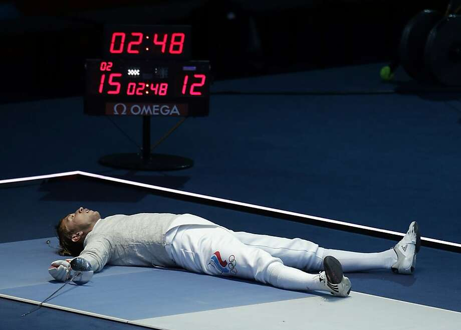 Russia's Nikolay Kovalev reacts after defeating Germany's Nicolas Limbach during the quarterfinals of the men's fencing individual sabre at the 2012 Summer Olympics, Sunday, July 29, 2012, in London. (AP Photo/Andrew Medichini) Photo: Andrew Medichini, Associated Press