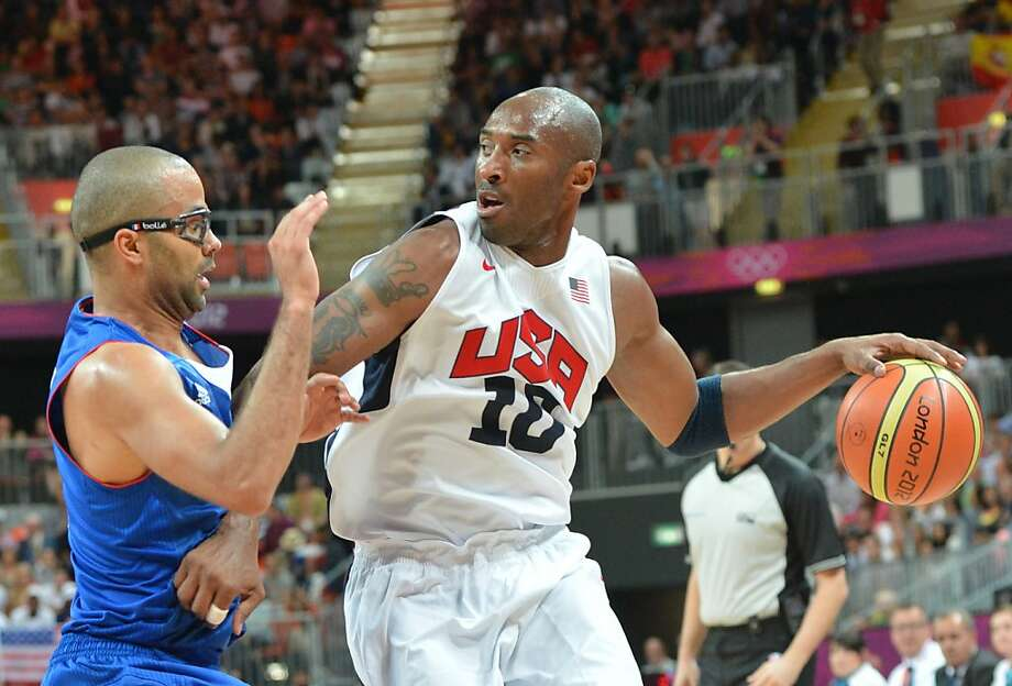TOPSHOTS US guard Kobe Bryant (R) is challenged by French guard Tony Parker during the Men's Preliminary Round Group A match United States vs France at the London 2012 Olympic Games , on July 29, 2012 in London.  AFP PHOTO / MARK RALSTONMARK RALSTON/AFP/GettyImages Photo: Mark Ralston, AFP/Getty Images