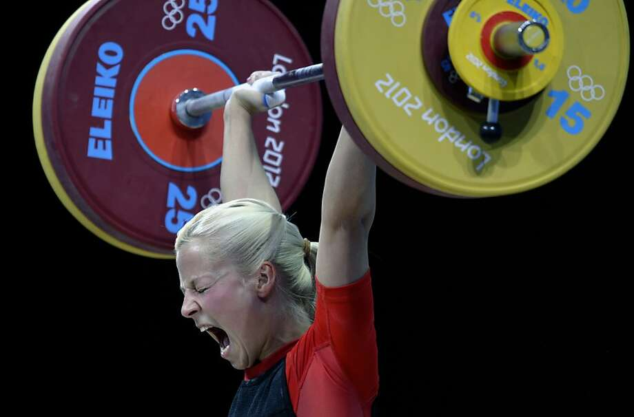 TOPSHOTS Germany's Julia Rohde competes during the weightlifting women's 53kg group B at the Excel Center in London during the 2012 London Olympic Games on July 29, 2012. AFP PHOTO / YURI CORTEZYURI CORTEZ/AFP/GettyImages Photo: Yuri Cortez, AFP/Getty Images
