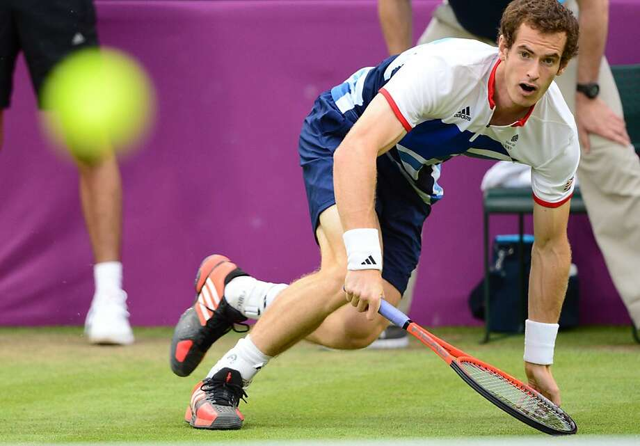 TOPSHOTS Andy Murray of Britain returns the ball against Stanistas Wawrinka of Switzerland during their men's singles tennis match at  the 2012 London Olympic Games at the All England Tennis Club in Wimbledon, southwest London, on July 29, 2012. AFP PHOTO / Martin BernettiMARTIN BERNETTI/AFP/GettyImages Photo: Martin Bernetti, AFP/Getty Images